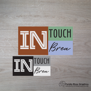 modern style logo with boxes in brown, green, blue and a black, gray, white version of the same logo on wooden background